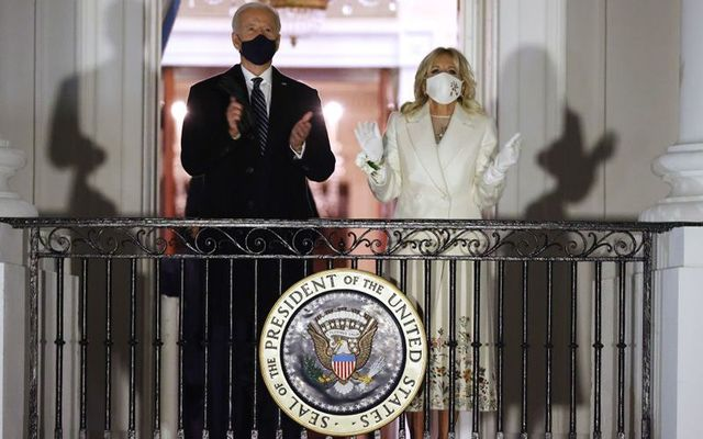 U.S. President Joe Biden and First Lady Jill Biden watch a fireworks show on the National Mall from the Truman Balcony at the White House following the inauguration ceremony at the U.S. Capitol on January 20, 2021 in Washington, DC.