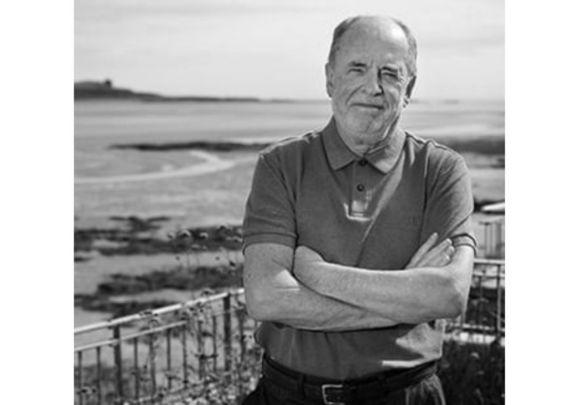 Irish Voice columnist of 34 years, John Spain.