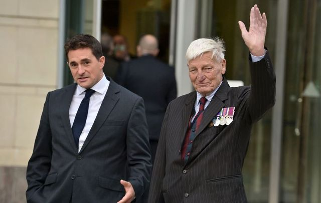 October 4, 2021; Dennis Hutchings (R) waves as he arrives at Laganside Court alongside former Conservative minister Johnny Mercer (L) in Belfast, Northern Ireland. Hutchings, a former member of the Life Guards regiment, has denied a charge of attempted murder in relation to the death of John Pat Cunningham, a 27-year-old man with learning difficulties who was shot dead as he ran from an Army patrol near Benburb, County Tyrone, in 1974. Hutchings has been a high-profile campaigner for veterans of the Northern Ireland conflict to receive greater protections from criminal prosecutions.
