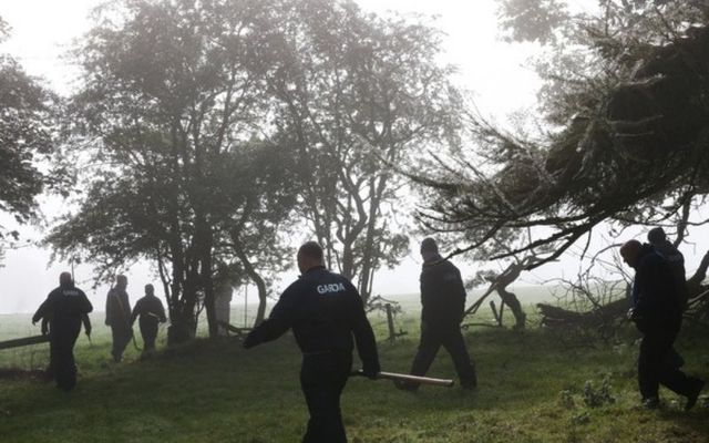 Gardaí search a wooded area near Usk Little in County Kildare.