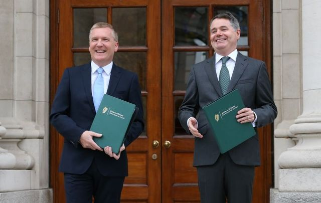 October 12, 2021: Minister for Public Expenditure and Reform Michael McGrath and Minister for Finance Paschal Donohoe outside Government Buildings before presenting Budget 2022 to Cabinet.