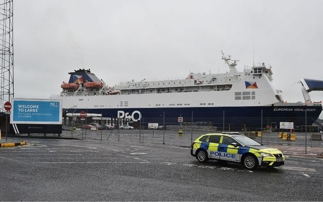 Police at Larne after sectarian messages threatened workers at the Northern Irish port