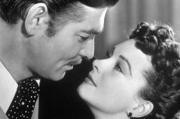 Vivien Leigh and Clark Gable as Scarlett O\'Hara and Rhett Butler in the MGM epic \'Gone with the Wind\', directed by Victor Fleming.