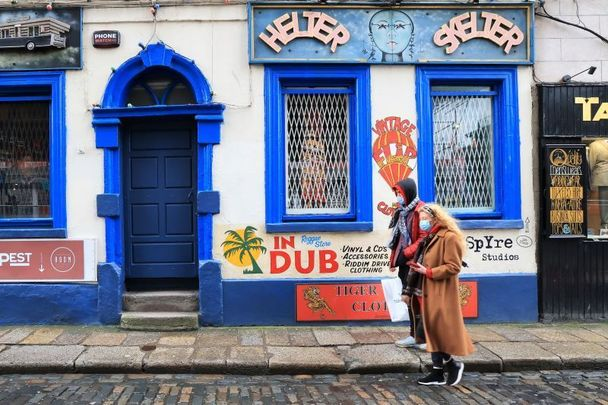 Masked pedestrians walking in Dublin.