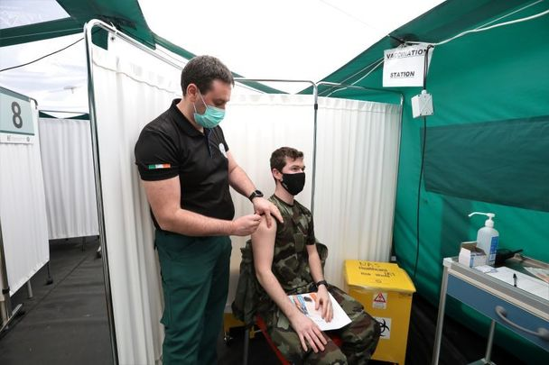 February 14, 2021: Paramedic William Masterson vaccinates Irish army private Gareth Quin as vaccinations of Health Workers, staff, and GP\'s take place on grounds of St Marys Hospital/Nursing Home in Phoenix Park.
