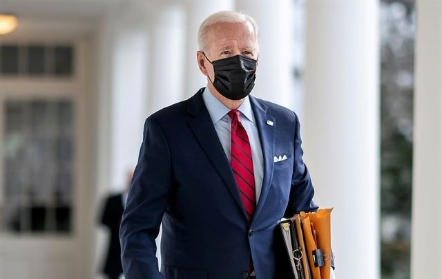 January 28, 2021: President Joe Biden walks along the Colonnade of the White House en route to the Oval Office.