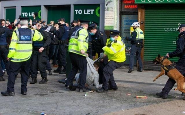 Gardaí apprehend a protester during Saturday\'s violent demonstration in Dublin City Center.