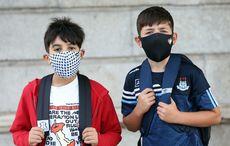 Thumb back to school boys mask covid via rollingnews