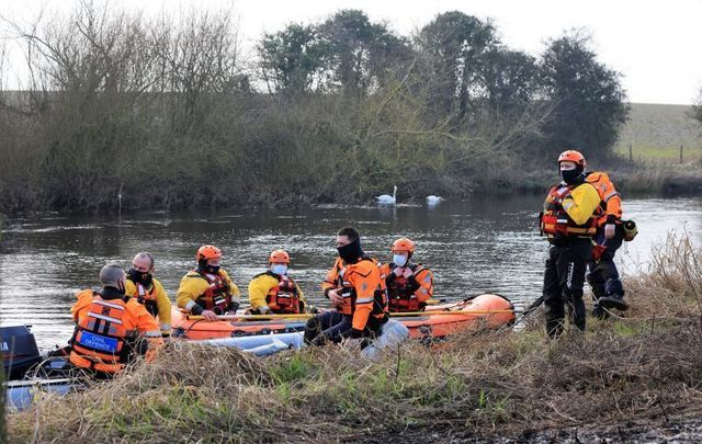 March 2, 2021: Members of local Civil Defence Emergency Services near Ardreigh Lock on the River Barrow outside Athy, County Kildare.