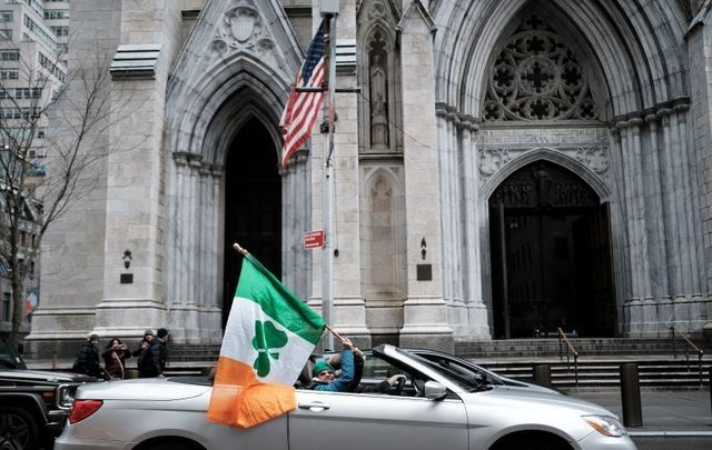 March 17, 2020: People celebrate St. Patrick\'s Day in front of St. Patrick\'s Cathedral even as the parade was canceled in New York City.