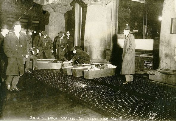Coffins of some of the 146 people who lost their lives in the Triangle Shirtwaist Factory Fire, of 1911, lie on the sidewalks