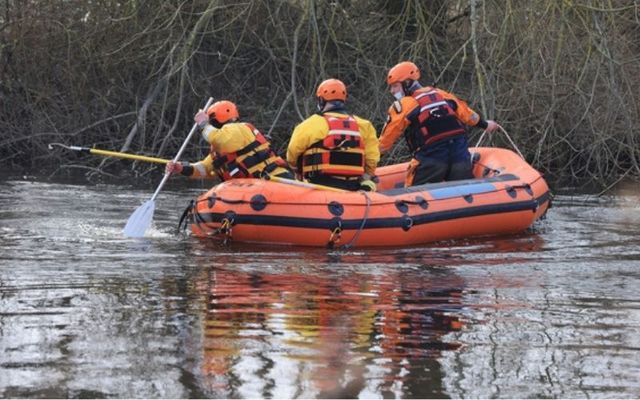 Members of the Civil Defence Emergency Services searching for Declan Reid\'s body.