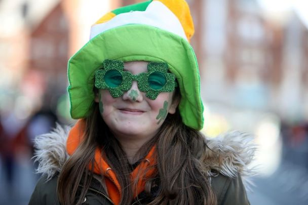 March 17, 2019: A child enjoying the St. Patrick\'s Day Parade in Dublin, Ireland.