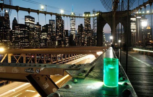 A green light for the Irish Diaspora shining on the Brooklyn Bridge in NYC.