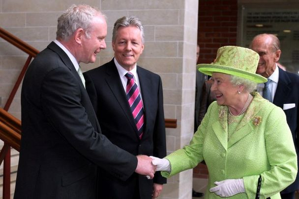 June 27, 2012: Queen Elizabeth II shakes hands with Northern Ireland Deputy First Minister Martin McGuinness, watched by First minister Peter Robinson (centre) at the Lyric Theatre in Belfast.