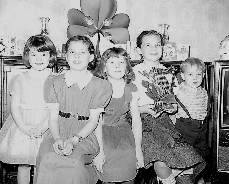 Kate (second from left) and her four siblings celebrating their Irish Ancestry on a St. Patrick's Day long ago.