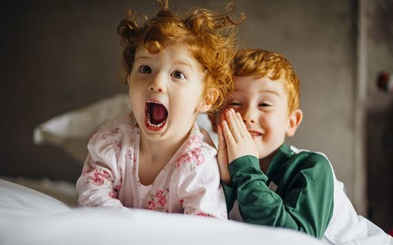 A pair of kids acting the maggot