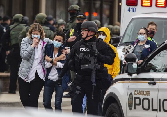 Healthcare workers walk out of a King Sooper\'s Grocery store after a gunman opened fire on March 22, 2021 in Boulder, Colorado.