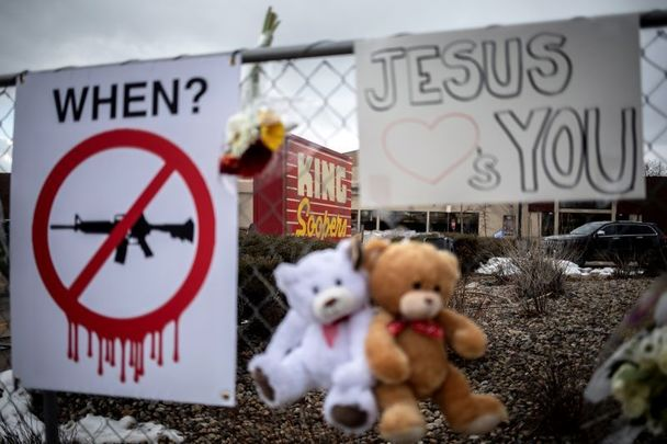 March 23, 2021: Memorials with signs, teddy bears, and flowers are left on the fencing surrounding the grocery store the day after a gunman opened fire at a King Sooper\'s grocery store on March 22, 2021 in Boulder, Colorado.