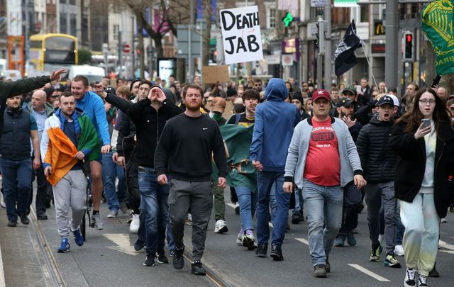 Protesters supporting a worldwide day of opposition to Covid-19 lockdowns marched in Dublin on March 20, 2021.