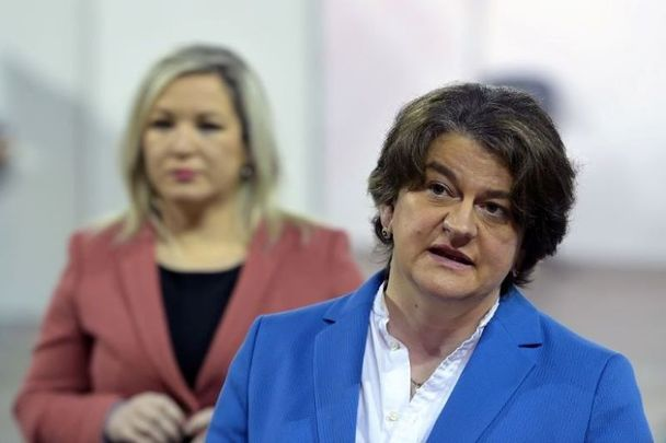 March 29, 2021: Deputy First Minister Michelle O\'Neill (left) and First Minister Arlene Foster hold at the Odyssey SSE Arena in Belfast, Northern Ireland.