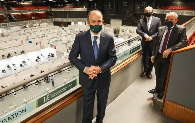 April 7, 2021: Taoiseach Micheal Martin, Phil O'Neill Chief Operations Officer HSE, and HSE CEO Paul Reid as the Taoiseach visited the HSE Covid-19 Vaccination Centre in the Citywest Conference Centre in Dublin