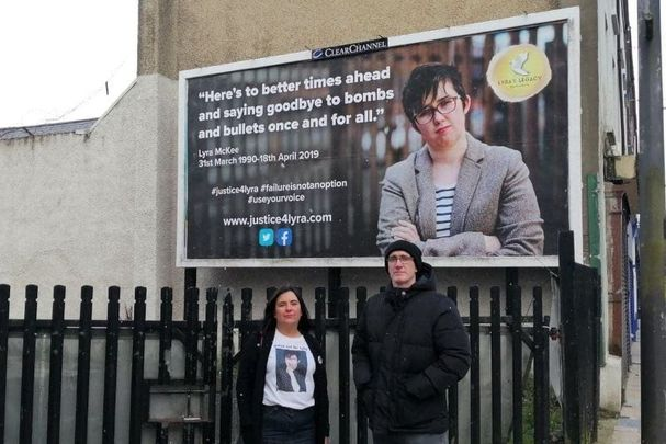 Lyra McKee\'s relatives standing in front of a recently unveiled Justice 4 Lyra billboard in Derry.
