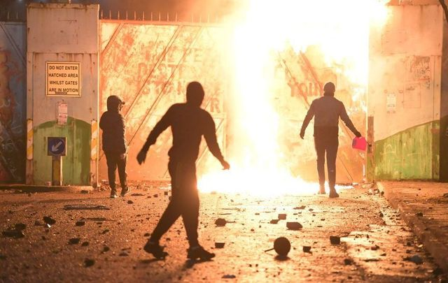 April 7, 2021: Fire fed by petrol burns as youths clashed at the Peace Gate at the Springfield Road/Lanark Way interface in Belfast. Violence broke out after a Loyalist protest, with youths attacking police officers and petrol-bombing a bus.