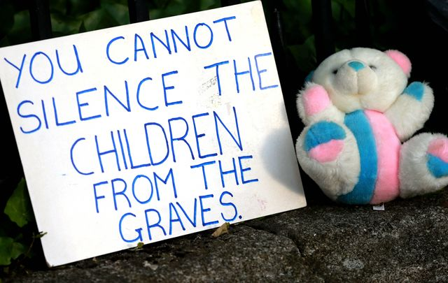 A placard outside Ireland\'s government buildings against the Mother and Baby Homes.