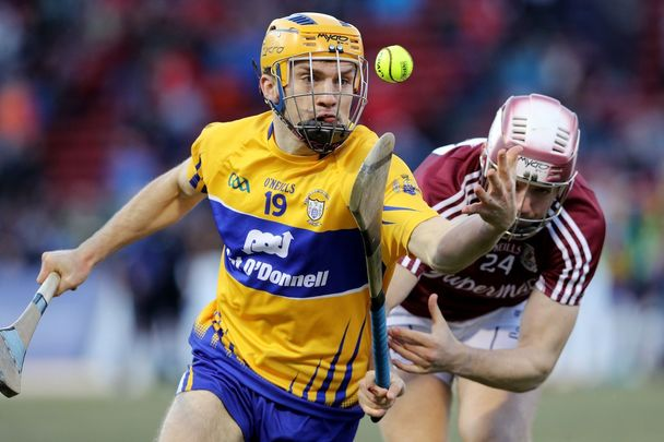 Nov 19, 2017: Shane O\'Donnell of Clare runs past Padraig Breheny of Galway during the 2017 AIG Fenway Hurling Classic and Irish Festival at Fenway Park in Boston, Massachusetts.