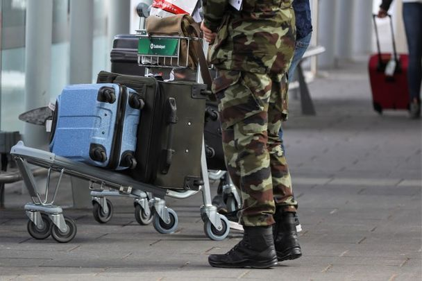 March 26, 2021: Members of the Irish Defence Forces escort passengers with their luggage from high-risk countries to their bus outside Terminal 2 in Dublin Airport.