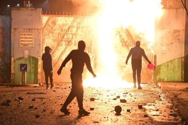April 7, 2021: Fire fed by petrol burns as youths clashed at the Peace Gate at the Springfield Road/Lanark Way interface in Belfast, Northern Ireland.