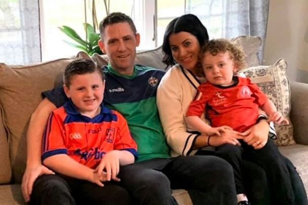 Mickey Coleman safely at home his wife Erin Loughran and their two sons.
