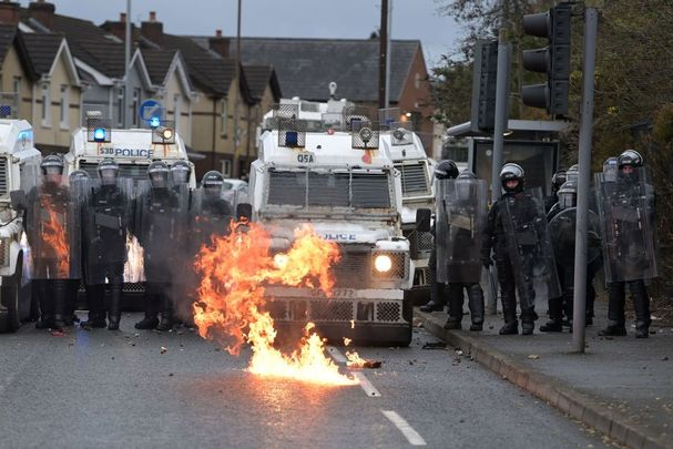 Nationalist attacking the police on Springfield Road, Belfast, close to the Peace Wall.