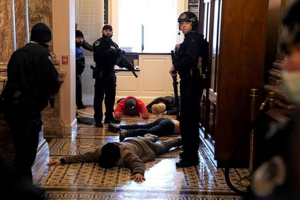 January 6, 2021: U.S. Capitol Police detain protesters outside of the House Chamber.