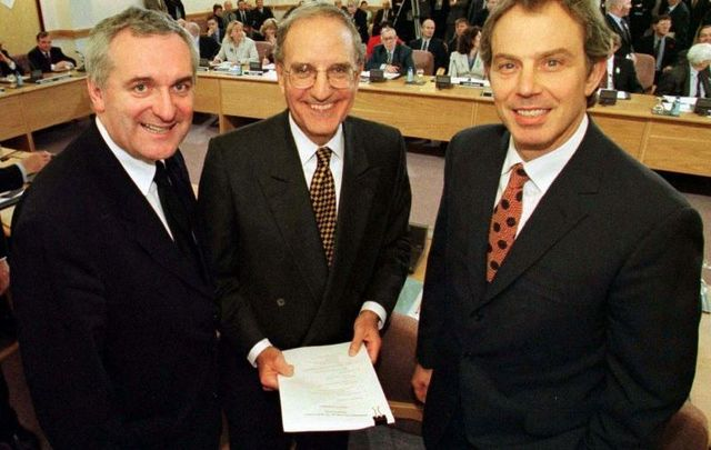 April 10, 1998: Taoiseach Bertie Ahern, Senator George Mitchell, and British Prime Minister Tony Blair at Castle Buildings Belfast, after they signed the peace agreement that will allow the people of Northern Ireland to decide their future.