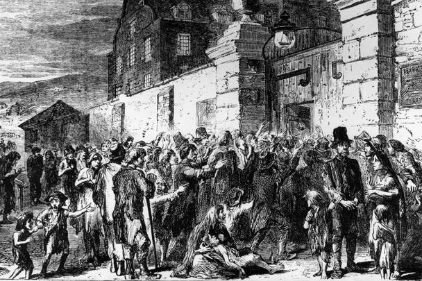 1846: Starving peasants clamor at the gates of a workhouse during the Irish potato famine.