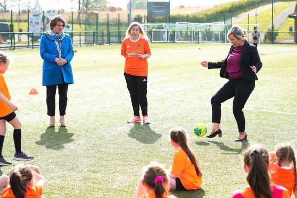 April 22, 2021: Arlene Foster and Michelle O\'Neill meet with young players from Mid Ulster Ladies Football Club ahead of relaxations coming into effect on April 23.