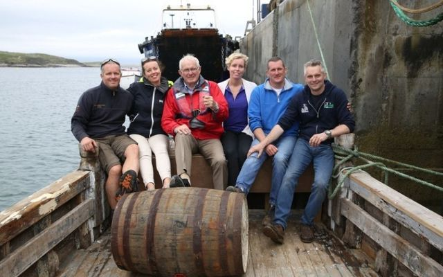 The O\'Grady family onboard the Dolphin, which is maturing single malt Irish whiskey at sea.