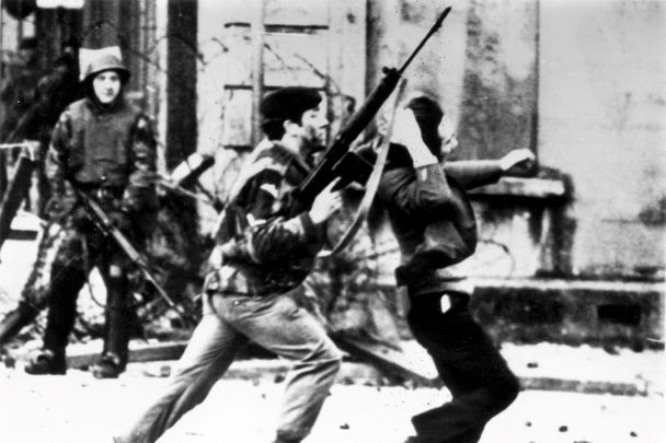 January 30, 1972: An armed soldier attacks a protestor on Bloody Sunday when British Paratroopers shot dead 13 civilians on a civil rights march in Derry City.