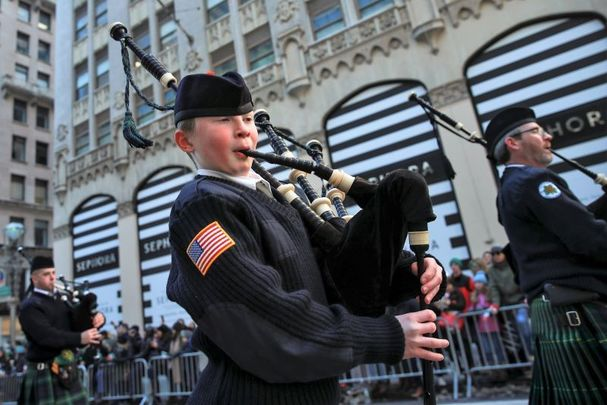 March 17, 2017: Members of the Xaverian High School Pipe and Drum band from Brooklyn march along 5th Avenue during the annual St. Patrick\'s Day parade in New York City. The New York City St. Patrick\'s Day parade, dating back to 1762, is the world\'s largest St. Patrick\'s Day celebration.