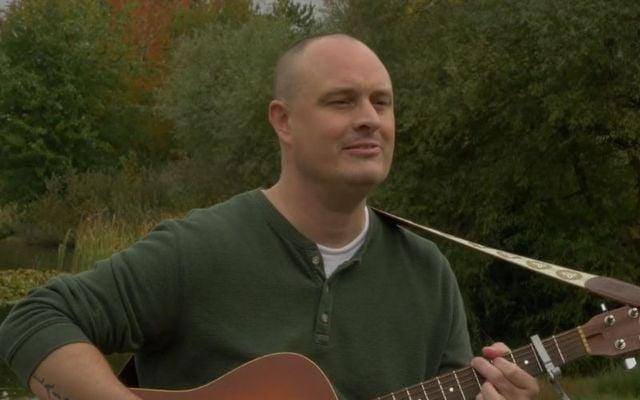 "Canadian musician David McCallum performs an Irish language song during the short film \""Idir Muir agus Spéir\""."