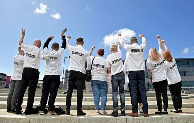 May 11, 2021: Relatives of victim Joseph Corr, wearing shirts that say \'The Truth is Free,\' react after the findings of the Ballymurphy Inquest were released by the coroner at the Waterfront Hall in Belfast, Northern Ireland.