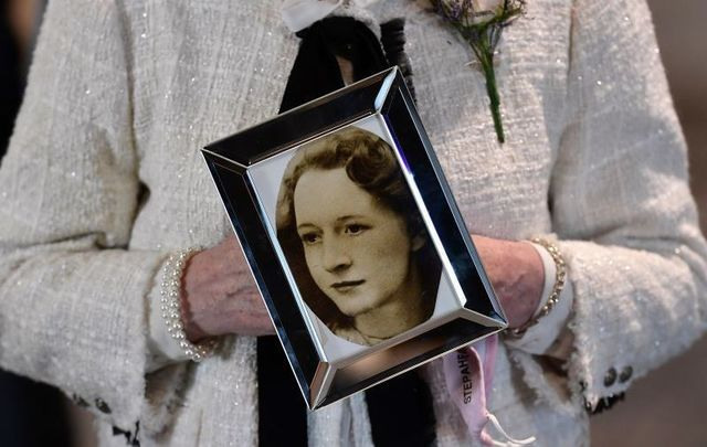 May 11, 2021: A relative of Joan Connolly holds a photograph of Joan after the findings of the Ballymurphy Inquest were revealed at the Waterfront Hall in Belfast, declaring all ten victims innocent.