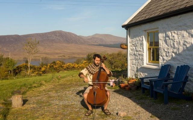 Patrick Dexter playing the cello outside his home in County Mayo