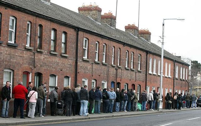 March 2009: People queue down Cumberland Street, Dun Laoghaire to collect their social welfare payments.