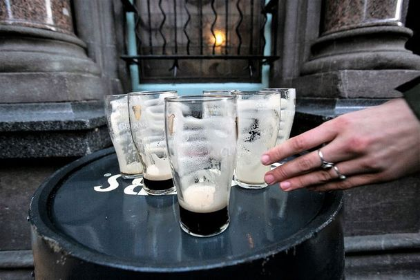 December 24, 2020: Empty pints of Guinness at the Stags Head in Dublin as pubs close at the 3 pm deadline in Dublin City Center.