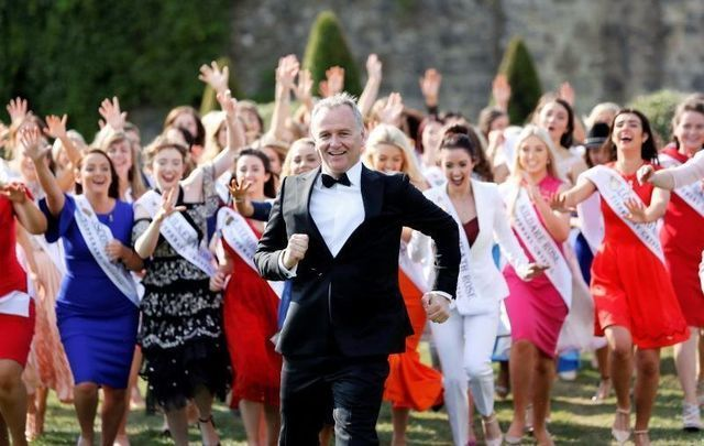 Dáithí Ó Sé, center, has been the host of the Rose of Tralee Festival in recent years.