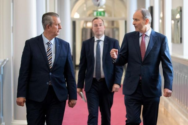 June 3, 2021: Edwin Poots (left) and Micheál Martin (right) walk ahead of Paul Givan (center) who is expected to become Northern Ireland\'s next First Minister.