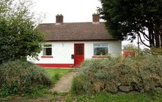 Own your very own red-doored cottage near an Irish lough for $220k